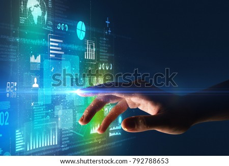 Female finger touching a beam of light surrounded by blue and green data and charts #792788653