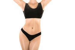 Female fit torso in black panties and top, isolated on white, woman rise her arms up. Base underwear, body care, fitness, weight, dieting and lifestyle concept