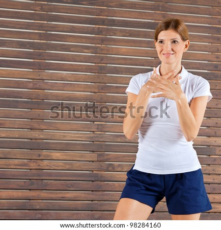 Female fitness trainer giving instructions in gym