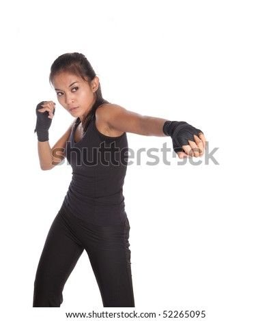 Female fitness trainer with one hand stretch in jabbing position - stock photo