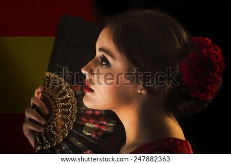 Female flamenco dancer with Spanish flag.