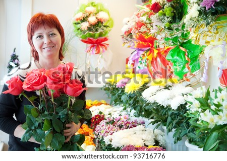 Female florist in her small  flower shop