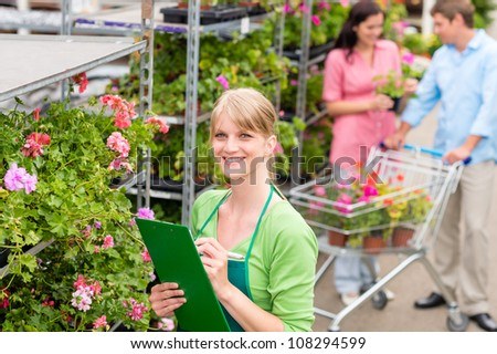 Female florist working at garden center retail inventory