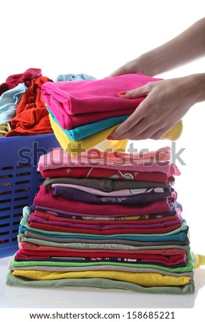 Female folding children\'s clothes on isolated background