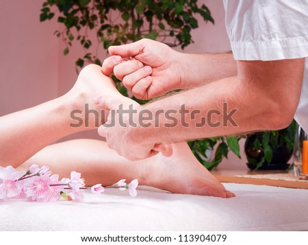 female foot massage at the spa