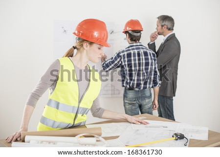 female foreman during a meeting about a build project