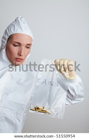 Female forensic scientist holding ammunition as evidence