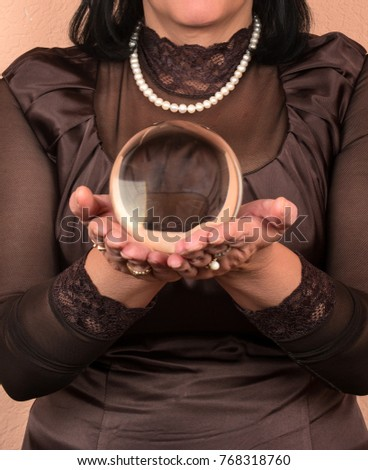 Female fortune teller holding in his hand the magic ball closeup #768318760
