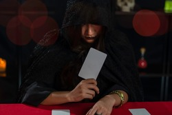 Female fortune teller read tarot cards to predict fortune.