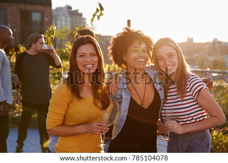 Female friends at a rooftop party smiling to camera #785104078