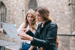 Female friends checking route on map