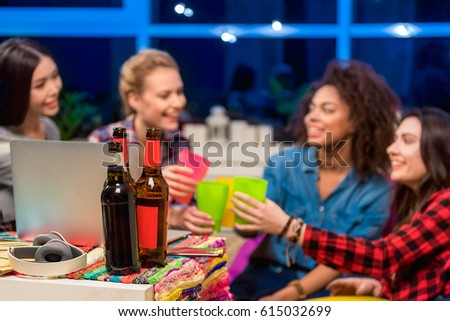 Female friends clanging glasses together