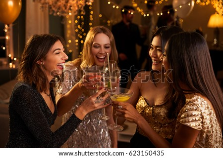 Female Friends Make Toast As They Celebrate At Party #623150435