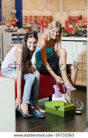 Female friends purchasing shoes