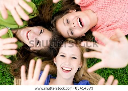 Female friends waving hands
