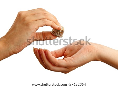 Female giving stack of coins to another person, isolated on the white background - stock photo