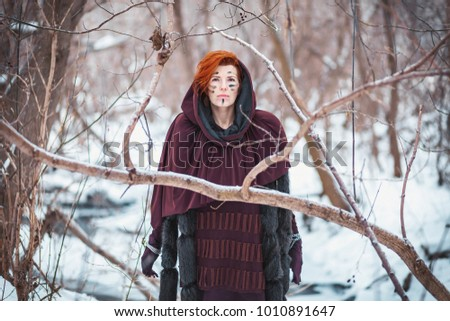 Stock Photo Female Gladiator. Historic image. Fox fur, fur. The woman warrior. War of the gladiators in the winter forest. The image of the historical film.