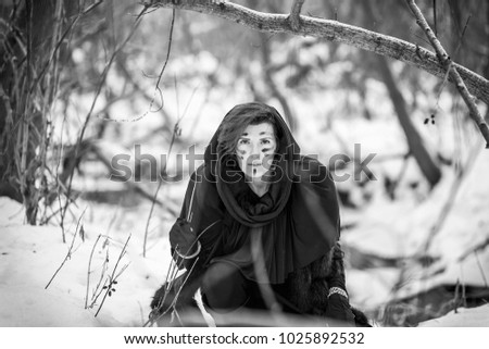 Stock Photo Female Gladiator. Historical image. Fox fur,and animal skins. Woman warrior. War of the gladiators in the winter forest. The image of the historical film. Gladiators.Historical costume.