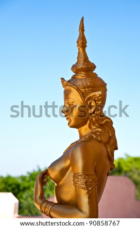 Female golden guardian angel at the temple, Thailand.