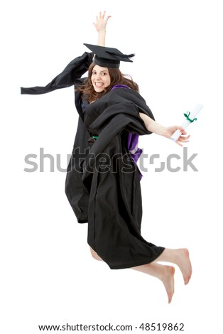 female graduate jumping and smiling full of joy over a white background