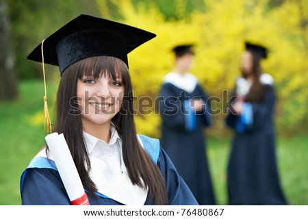 female graduation student in the park cheerful and happy