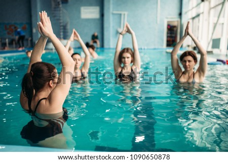 Female group on aqua aerobics in swimming pool