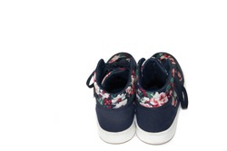 Female gym shoes on a white background. Shoes on a white background. Sports shoes on a white background