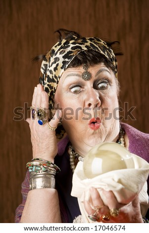 Female gypsy fortune teller with a crystal ball