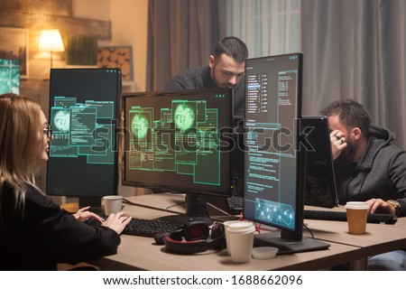 Female hacker with her team of cyber terrorists making a dangerous virus to attack the government.