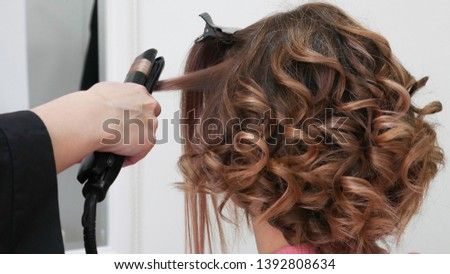 Female Hairstyles on curling in a beauty salon  #1392808634