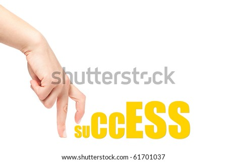 Female hand climbing over the word success, isolated on white background