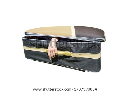 Female hand coming out of a suitcase. Imitation of the murder of a woman by a maniac or serial killer.