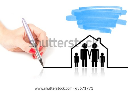 Female hand drawing a house over a family