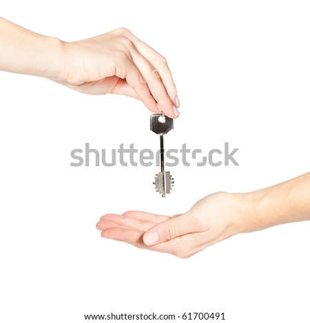 Female hand giving a key isolated on white background
