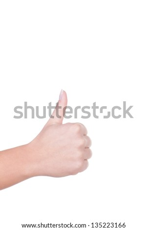 Female hand giving a thumbs up gesture of success and approval isolated on white with copy space above