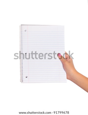 Female hand holding a blank page in a spiral notebook
