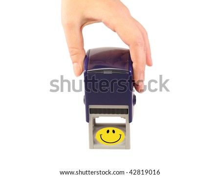 female hand holding a blue stamp on white background