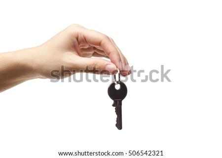 Female hand holding a key isolated