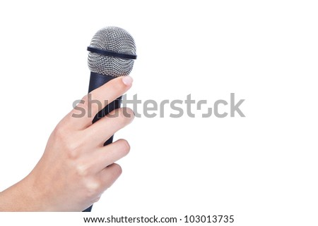 female hand holding a microphone