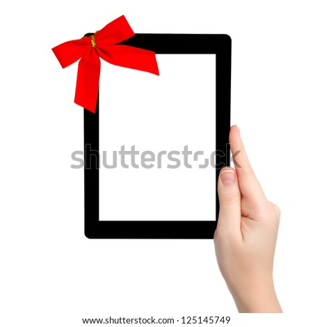 female hand holding a tablet touch computer gadget with isolated screen and a red gift bow