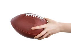 Female hand holding American football on isolated white background.