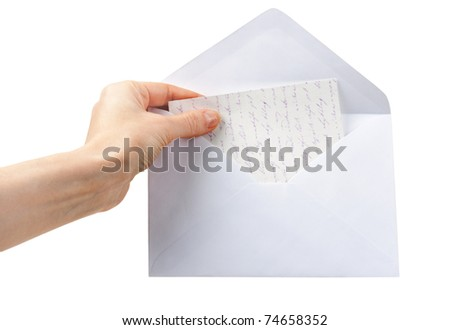 female hand holding an envelope isolated on a white background