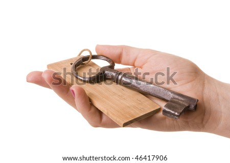 Female hand holding an old rusty key