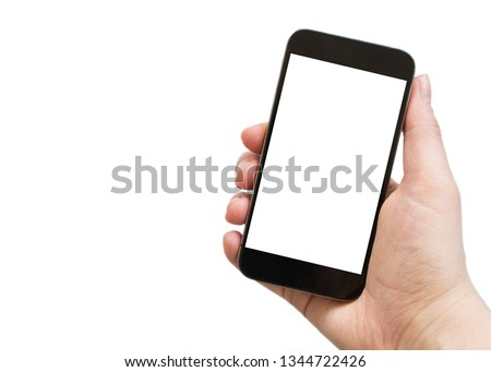 Female hand holding black cellphone with white screen at isolated background.  #1344722426