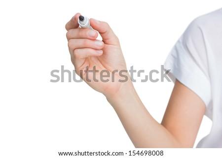 Female hand holding black whiteboard marker on white background
