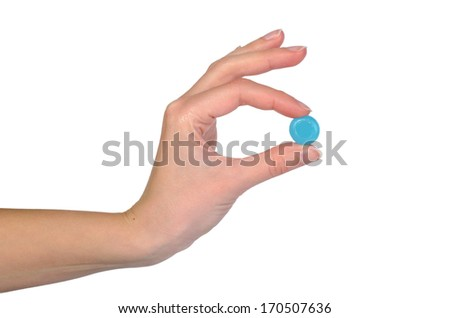 Female hand holding blue tablet isolated on white