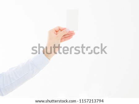 female hand holding business card isolated on white background. Copy space