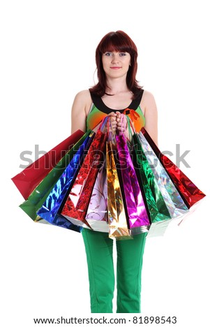 Female hand holding colorful shopping bags isolated on a white background