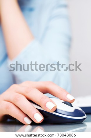 Female hand holding computer mouse