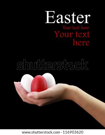 Female hand holding Easter eggs